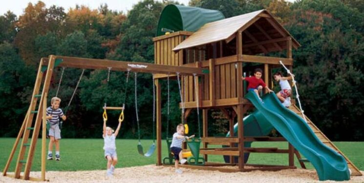 wooden playhouse and swing set